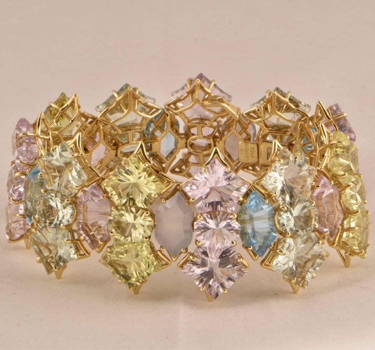 Beautiful Pink (app. 80 ct.), Green Amethyst (app. 62 ct.), Lemon Quartz (app. 47 ct.), Blue Topaz (app. 26 ct.) and Natural Chalcedony (app. 20 ct.) Statement  Gold Bracelet; Signed: TONY DUQUETTE 18K; measuring approx. 8.25