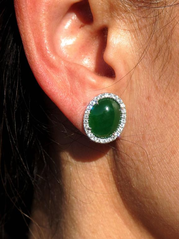 Featuring a pair of Beautiful Oval Cabochon cut Natural Jadeite Jade measuring approx. 13.48 x 10.06 x 4.18mm; 4.71 ct and 13.49 x 10.49 x 4.02mm; 4.56 ct; total 9.27ct, vivid green; Burma, (N) Type A = not enhanced; FTIR-tested;