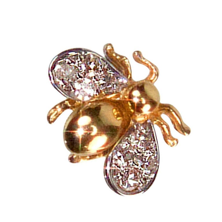 Adorable Gold Fly Pin with Bulbous Gold Body and Diamond set Wings. Hand Crafted in 14K Yellow Gold. Approx. size: 0.50