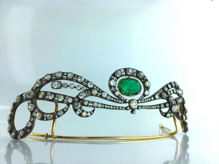 A unique masterpiece Tiara in silver and gold 18k 750. Old-mine cut diamond (approximately 27.00 carats) centered by a pendent cabochon Emerald weighting 8.50 carats.  Made-to-measure case.  Unbelievable, this Museum piece is collectable!  Height: