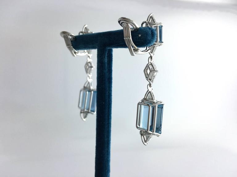 Stunning Pair of Ear pendants. This piece is all in platinum, composed by four Aquamarine and highlighted  by losange and triangle cut Diamonds of the best quality as usual for a Harry Winston creation.