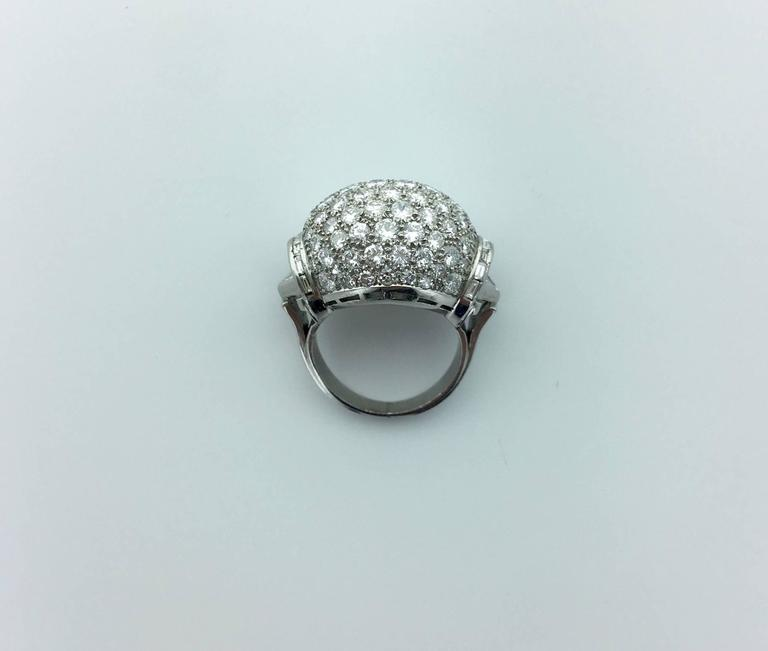 Top Design, Perfect Taste! All pave Diamond (approximately 8.00 carats) on Platinum Ring. Circa 1940.  Gross weight: 18.14 grams.