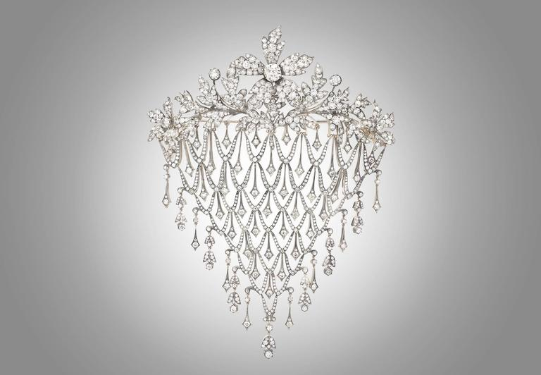 We are honored to have this masterpiece very large brooch converts to tiara in our collection. It is so magnificent and impressive that it cannot be compared. Stomacher Brooches are very rare and this one is so significant that it could be in a