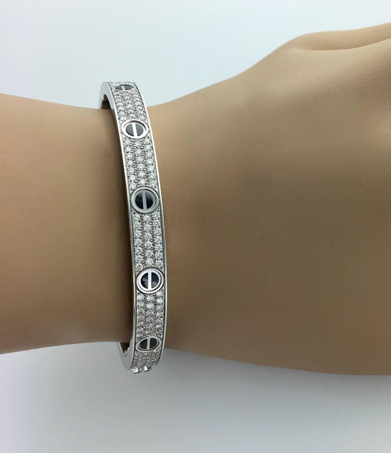 Love bracelet, white gold 18k 750, black ceramic, set with 204 brilliant-cut diamonds totaling 2.18 carats.  Size 18.   Signed Cartier and numbered.