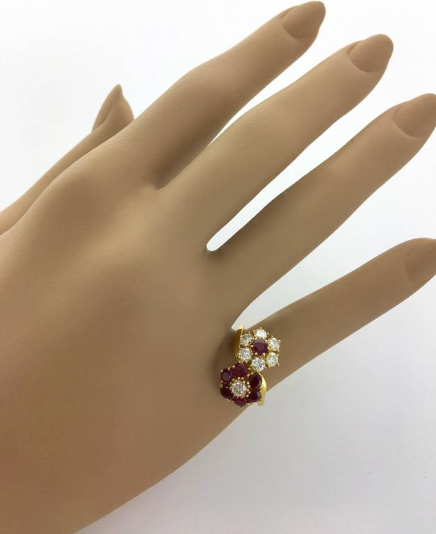 So Adorable! This classical from Van Cleef and Arpels is perfect. Two flowers in Ruby and Diamond on a yellow gold ring.  Signed, numbered and French marks.  Size: 7 1/2  Can be sized if required.  Gross weight: 5.57 grams.