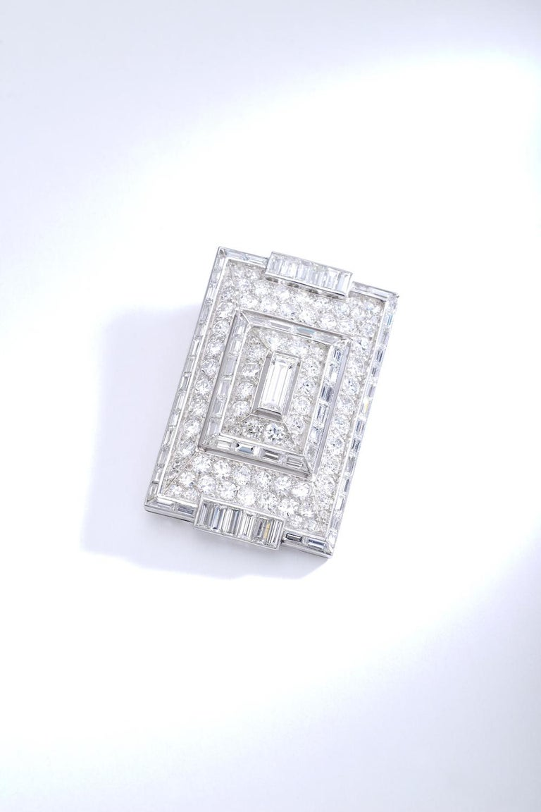 This piece is a wonderful creation of top quality. The modernist design of Art Deco period. Diamonds are white and clean Round and Baguette cuts perfectly matching. The clasp is also in Baguette cut Diamond. The Pendant is convertible in