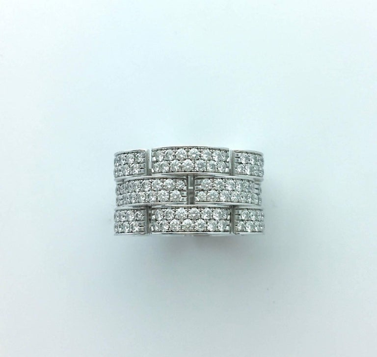Strong and Massive this Diamond pave on White Gold Band Ring by Cartier is a part of the Panther collection. Contemporary. Perfect condition.  Signed, numbered and marked. Size: 8 (Eu 57)   In his Cartier Box.