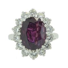 4.50 Carat Oval Ruby Diamond Gold Cluster Ring