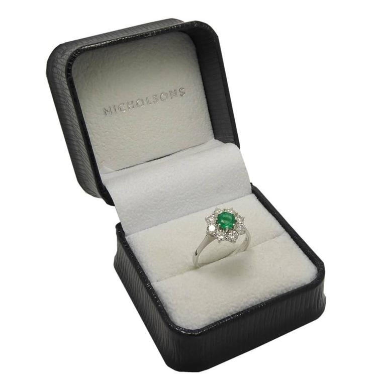 Contemporary Vintage Emerald and Diamond Cluster Style Engagement Ring 18 Carat White Gold For Sale