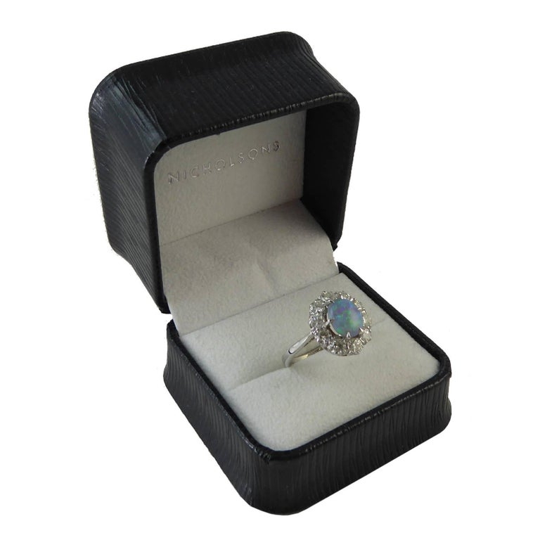 Pre-Owned Opal and Diamond Cluster Ring In Excellent Condition For Sale In Yorkshire, West Yorkshire