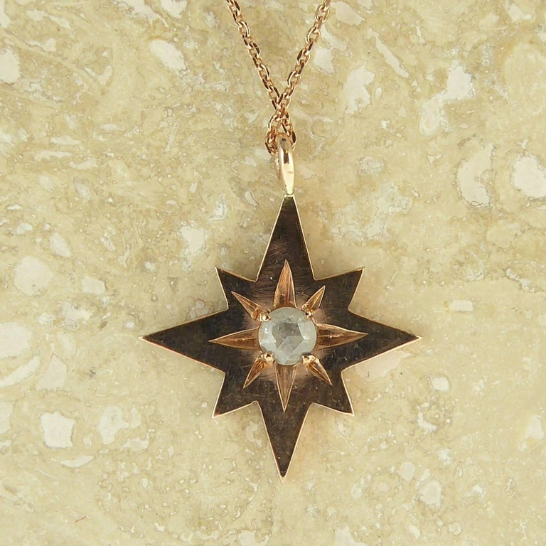 A delightful modern interpretation of a vintage style pendant created in a warm and glowing rose gold.  The pendant is in the form of an eight-pointed star and has been set to the centre with a rose cut diamond in a star shaped setting that