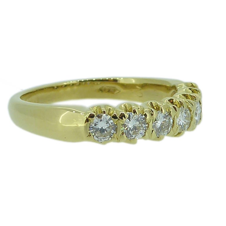 Seven bright diamonds have been bead set in yellow gold in a row across the finger creating a timeles diamond band that may be worn as either a wedding ring or eternity band.    A classic style that just doesn't date.  Details       7 x brilliant