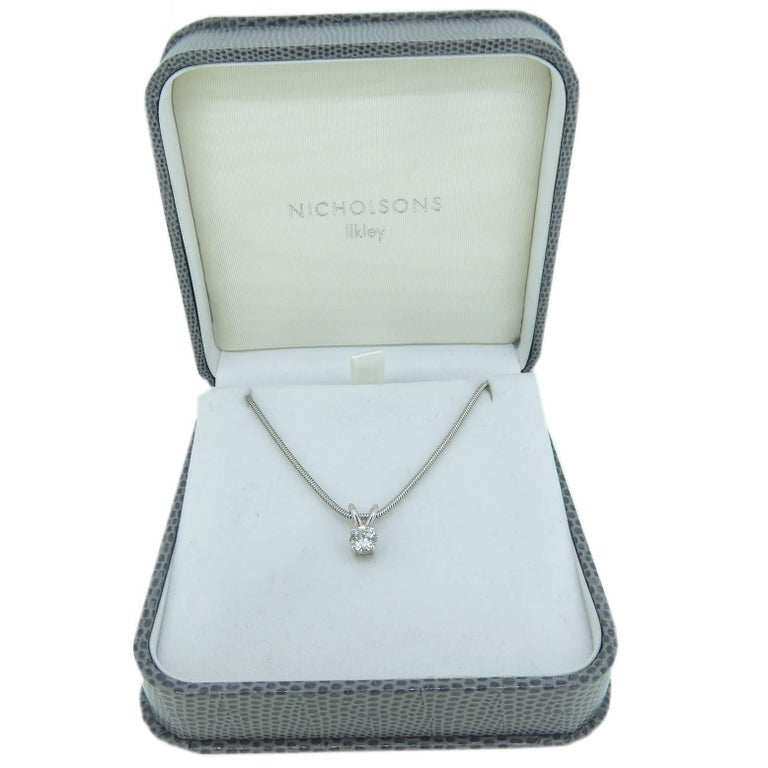 Contemporary Vintage 0.65 Carat Diamond Solitaire Necklace with 18 Carat White Gold Chain For Sale