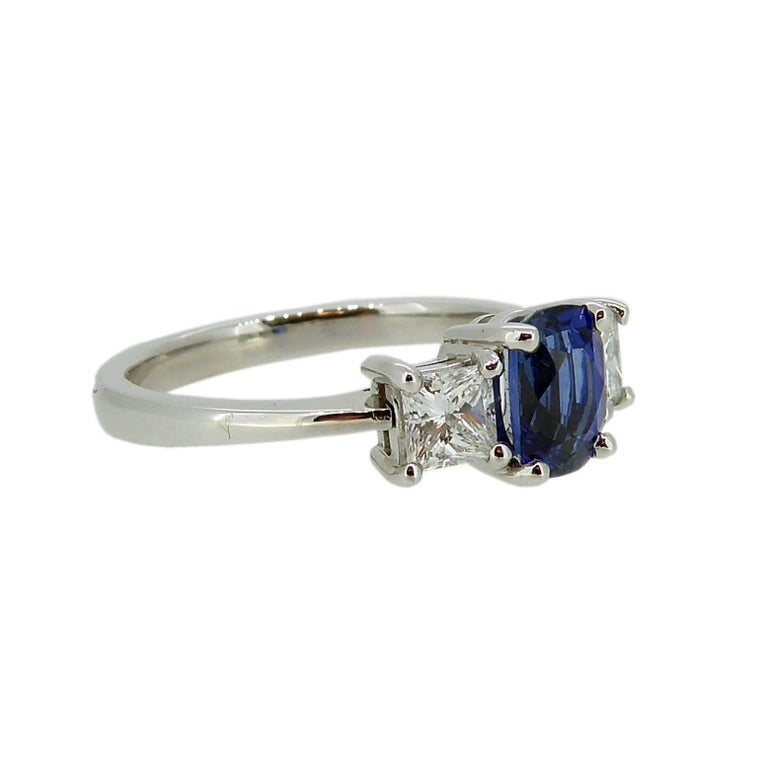 This sapphire and diamond ring is a classic choice in the search for traditional engagement or right hand rings.   The sapphire we have used in this trilogy of gemstones is a beautiful rich blue and, although oval in shape, we have chosen a four