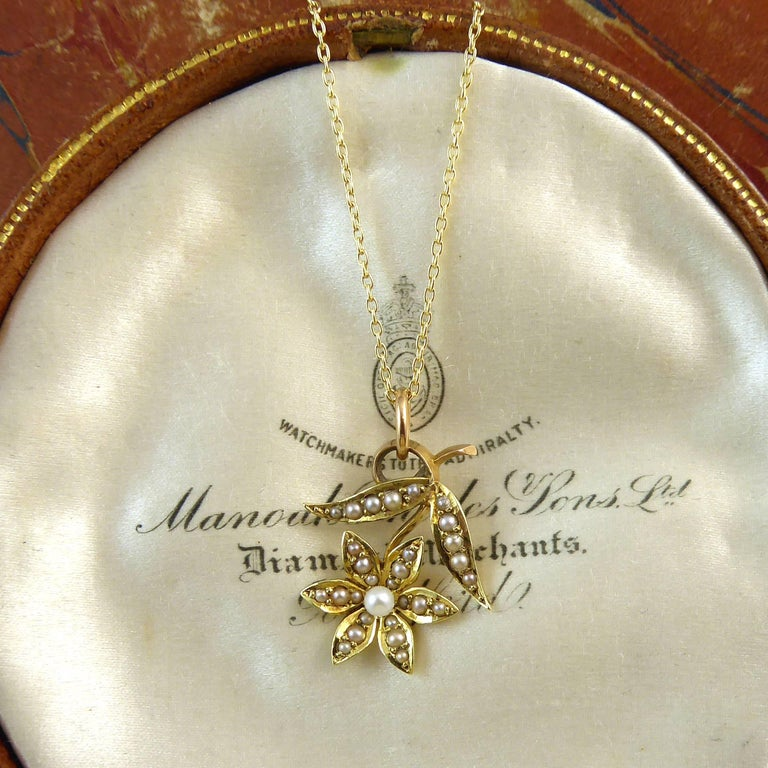 Delightful Victorian pearl pendant created in 15ct gold of a flower and leaf design all set with lustrous creamy white pearls.  The pendant is dainty and feminine and would be perfect to be worn on many occasions throught life and an ideal gift for