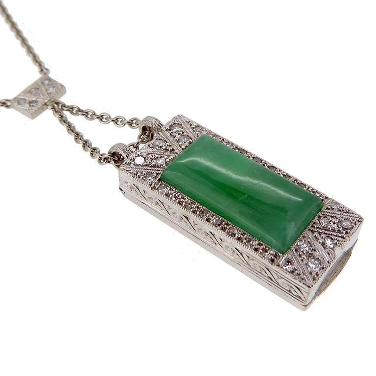 Previously worn as a cocktail watch,  absolutely stunning reworking of an Art Deco Diamond jewel into a very special jade and diamond necklace.  The jade is a cabochon cut cut rectangle, custom cut for the pendant and set within a diamond surround