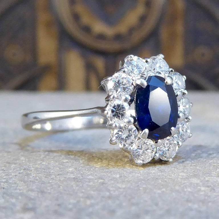 This gorgeous cluster ring features a single 0.75ct blue sapphire stone surrounded by a total of 0.55ct of diamonds. The stones glisten and sparkle in the light, and are slightly raised from the finger with an 18ct white gold setting.  A splendid