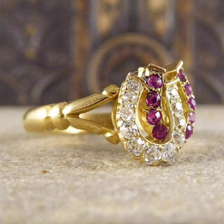 Complete your look with this double horseshoe ring set with ruby and diamond stones. Crafted in the Edwardian era and set in 18ct yellow gold, it looks delightful on the hand!  Ring Size: UK L 1/2 or US 6   Condition: Very Good, slightest signs of