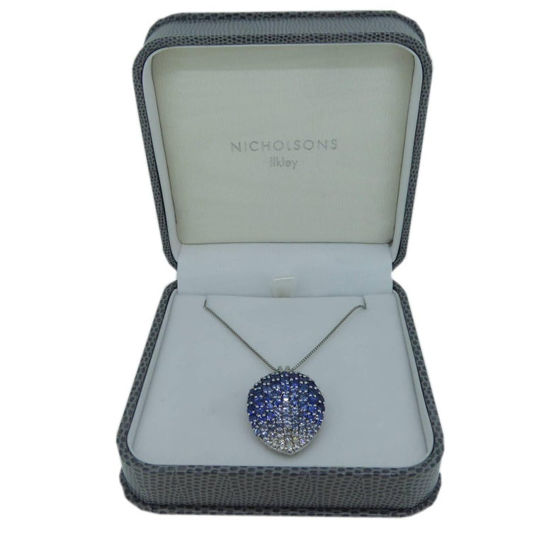 Round Cut Contemporary Diamond, Blue Sapphire and White Sapphire Pendant For Sale