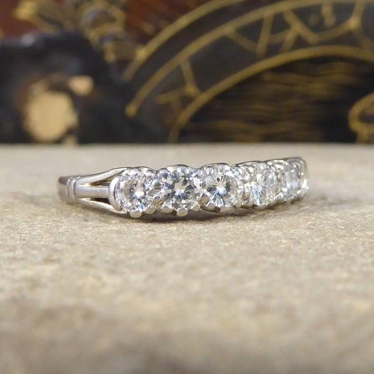 This beautiful seven stone Diamond ring has been set 18ct white gold. Featuring a level row of Diamonds all of the same size, totaling 0.78ct sat on stylishly formed shoulders. It dazzles and sparkles on the finger with well matched clear and bright