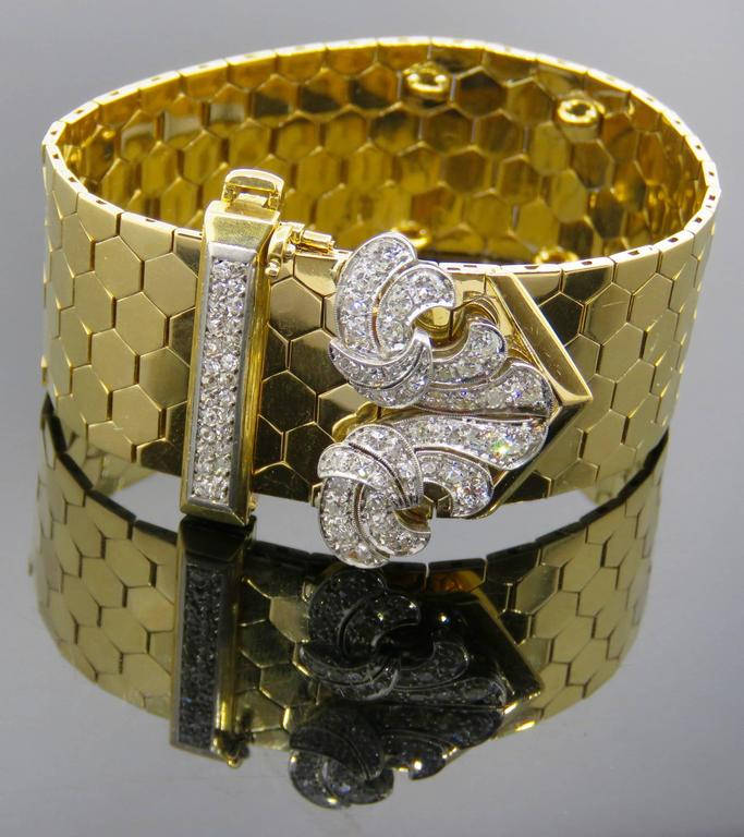 Elegant and classic retro gold Van Cleef & Arpels buckle bracelet studded with 68 diamonds.