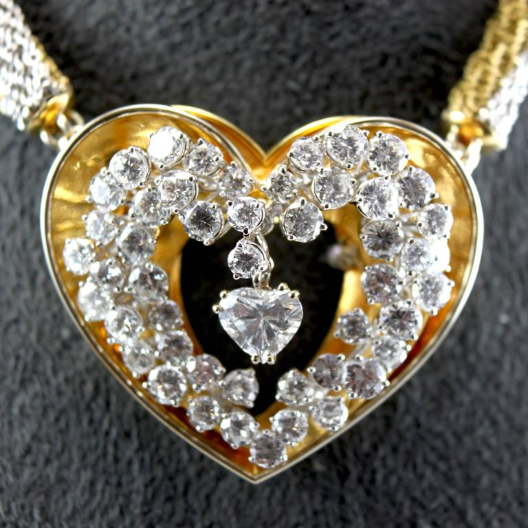 A loving 18k yellow and white gold diamond heart pendant, by ME Riedel.