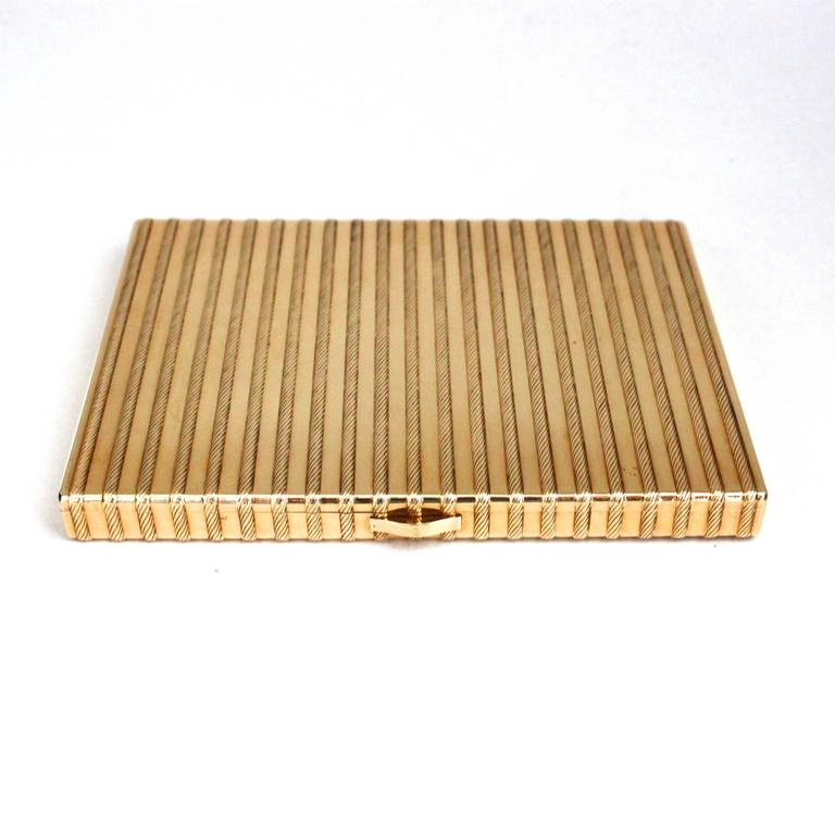 A beautiful Cartier Gold Cigarette Case, ca. 1940s-1950s, with a beautiful design of ropes all around it, made in 18k gold. A cigarette safety latch is installed inside the compartment.  Signed Cartier Paris, numbered, hallmarked.