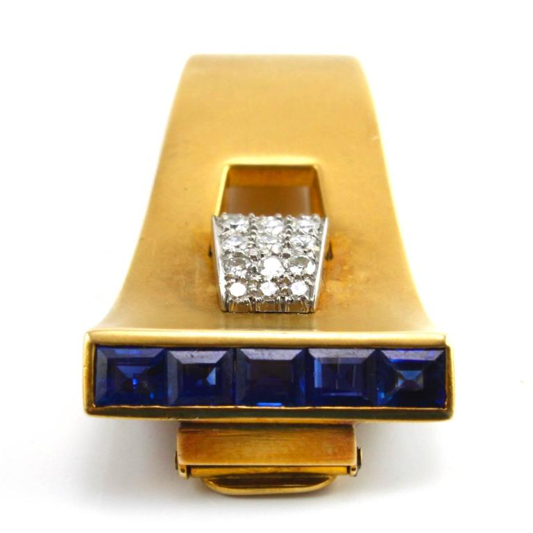 A very sleek and elegant Sapphire and Diamond Clip Brooch made in the 1940s, depicting the typical Retro design.  The diamonds weigh circa 1 carats and the sapphires weigh circa 1.5 carats. Both are of excellent quality.