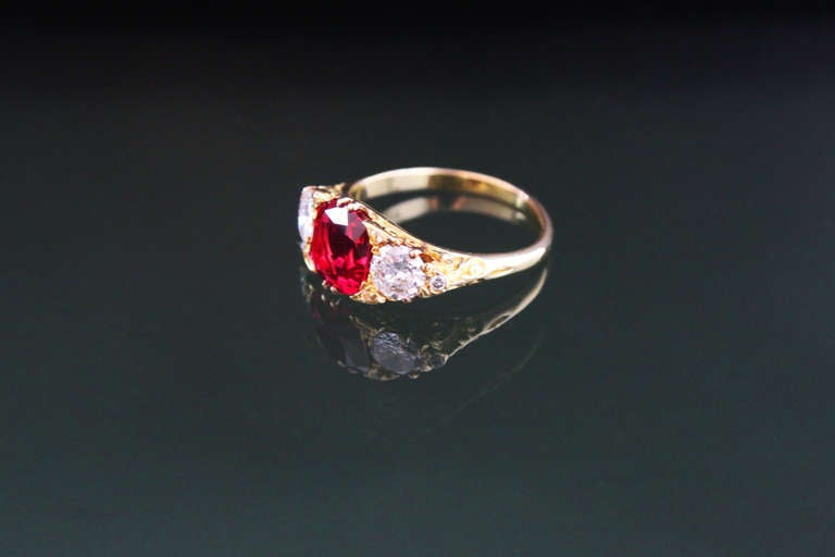 This is an elegant Victorian ring from the 1900s set in the center with a gem quality natural Burma spinel of 3.13 carats and diamonds of circa 1.2 carats. The spinel has a very fine luster and colour and has additionally no visible inclusions. This