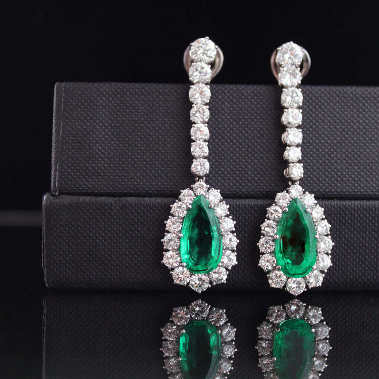 Important emerald and diamond earrings from the 1970s, each set with beautiful Old Mine Colombian emerald and surround by round brilliant cut diamonds of a very fine quality. The emeralds weigh 8.67 carats together and the total diamond weight is