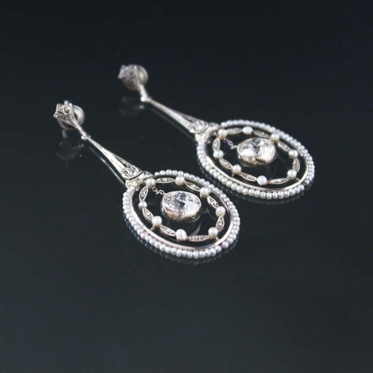 Lovely belle epoque pendant earrings with a perfect pair of diamonds weighing circa 1.10 carat each (circa G/VS1 quality) and surrounded by small seed pearls.
