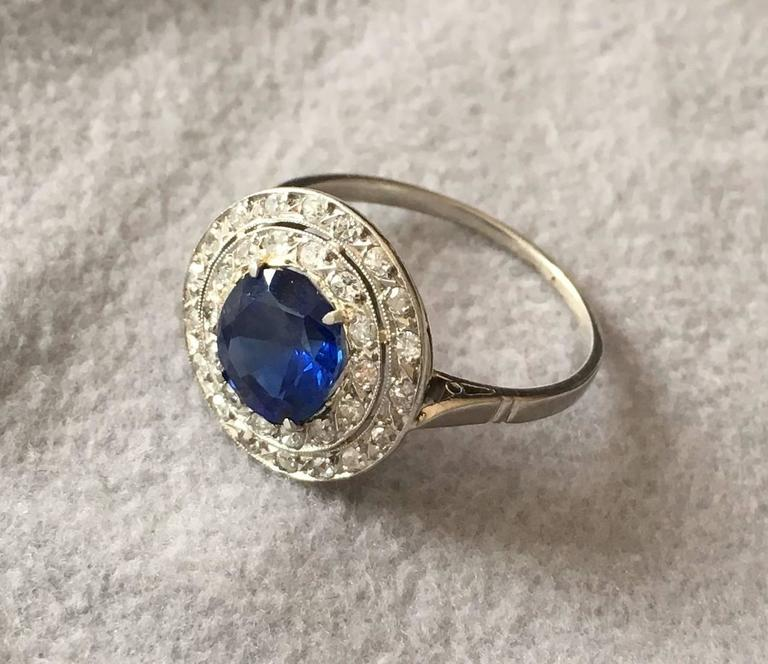 A wonderful Edwardian ring with a rare natural unheated Burma sapphire in the centre. The sapphire is a round brilliant cut stone and has a deep blue colour with a beautiful crystal. It comes with a certificate from the Swiss gem lab SSEF, stating
