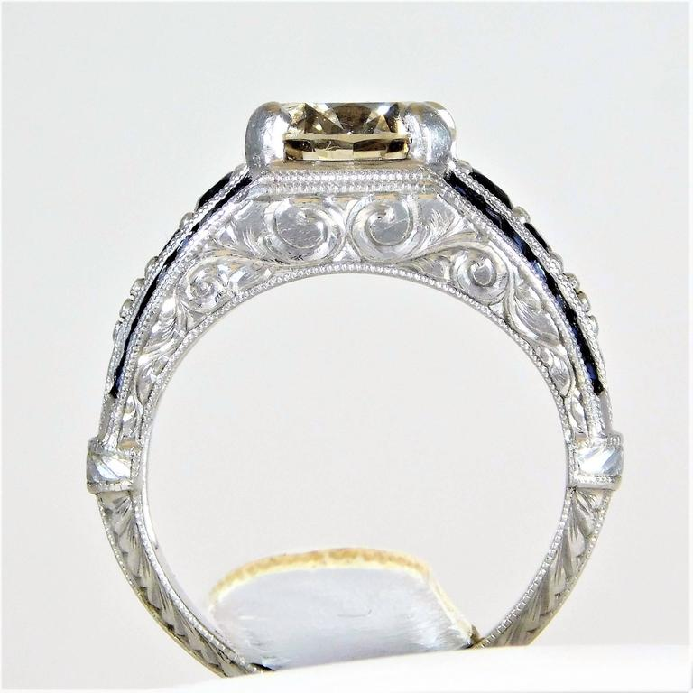 Ornate custom made sapphire and champagne colored diamond for What is platinum jewelry made of