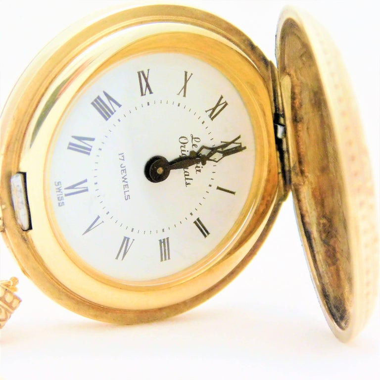 From a French Creole estate.  Circa 1915.  This gorgeous antique pocket watch pendant necklace has been crafted in 14k gold.  Everything on this watch is completely original.  The manual 17 jewel movement is stem set and in perfect working
