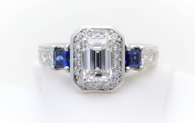GIA Certified 14k Emerald-Cut Diamond and Ceylon Sapphire Engagement Ring    From a stately New Orleans estate.  Circa 1970.  This exquisite ring has been hand crafted in solid 14k white gold.  It is masterfully jeweled with an opulent GIA certified