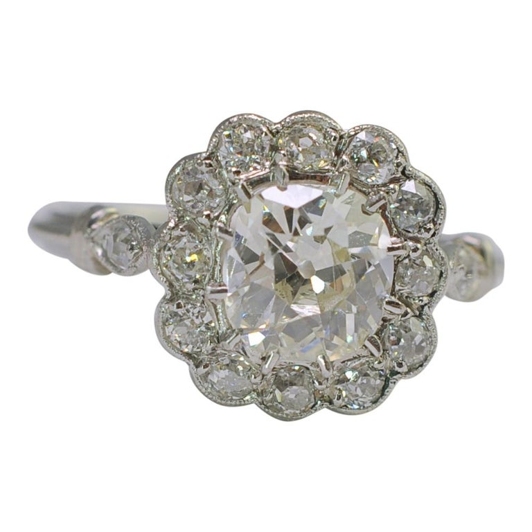 Art Deco Diamond Halo Platinum Engagement Ring
