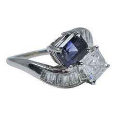 GIA Certified 1.64 Carat Diamond Sapphire Platinum Crossover Ring