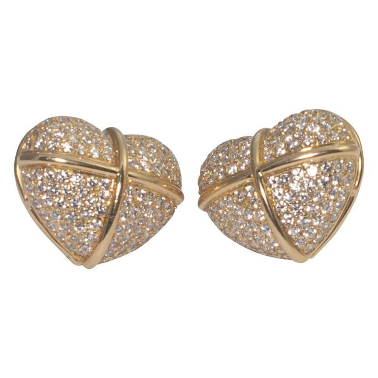 Large diamond set heart shaped earrings by Chopard; these lovely earrings are set with brilliant cut diamonds weighing a total of 5cts.  They are mounted with a post with a large butterfly back fitting for extra security.  Weight 21gms; width 2.5cms