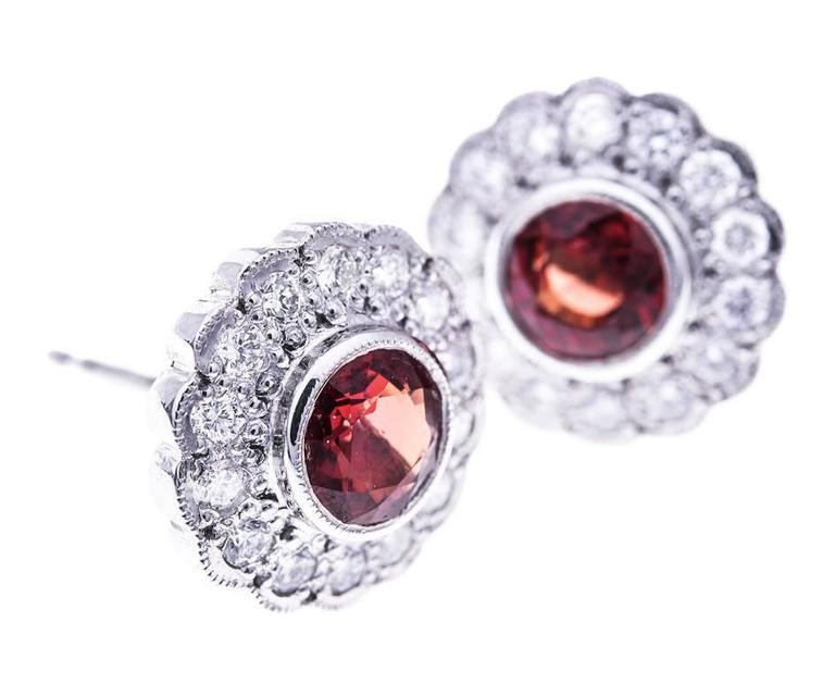 Fabulous round faceted bright orange sapphires framed with beautiful sparkling diamonds in a delicious floral cluster design. These gorgeous British made cluster earrings will make a lovely gift for a sapphire occasion or a September birthday.