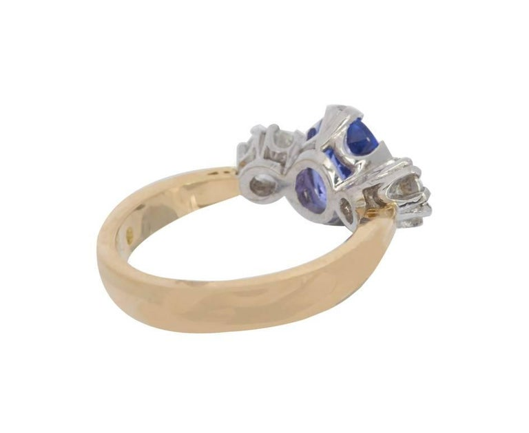 18 Carat Gold 2.33 Carat Tanzanite and 0.86 Carat Diamond Trilogy Ring In New Condition For Sale In Birmingham, GB