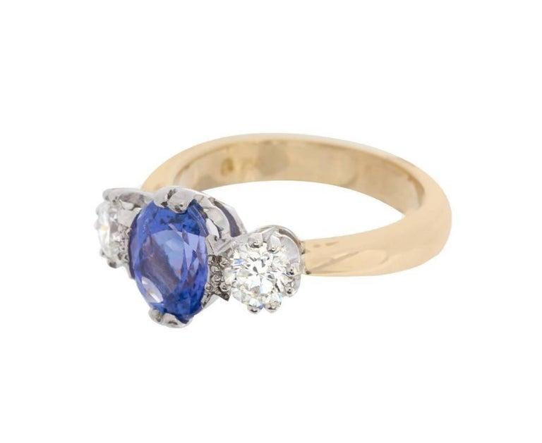 Modern 18 Carat Gold 2.33 Carat Tanzanite and 0.86 Carat Diamond Trilogy Ring For Sale