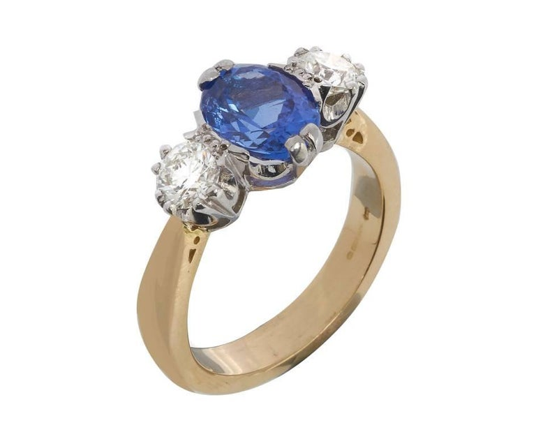 A classic trilogy ring design, centrally set with a 2.33ct tanzanite between two round brilliant cut diamonds totalling 0.86ct. The gems are set in traditionally styled white claws to yellow chenier shoulders and shank. A lovely idea for celebrating