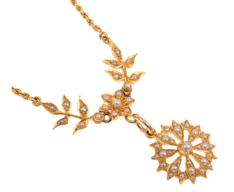GEMMOLOGIST'S NOTES This glorious late Victorian necklace, decorated with floral influences and set throughout with creamy split pearls, suspended beautifully from a later added 18ct gold chain.  A remarkable piece, that still boasts beauty today.