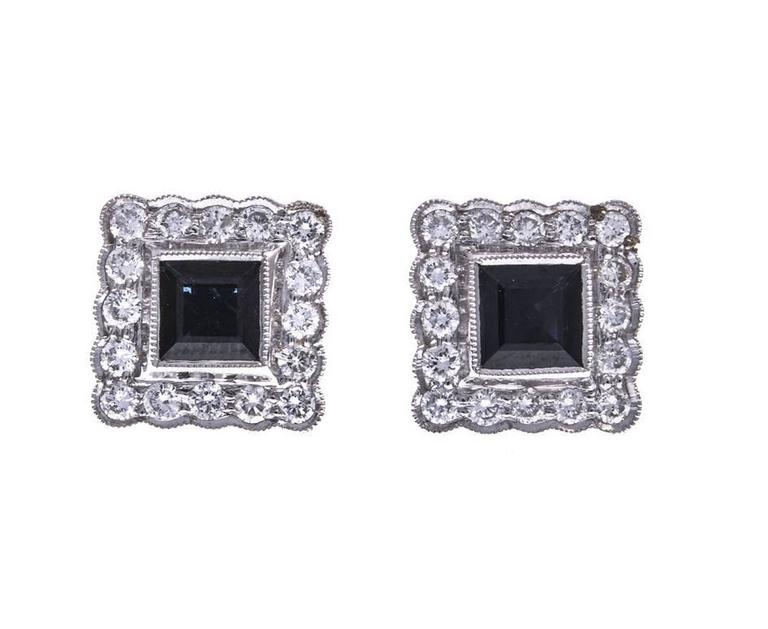 Rich blue square cut sapphires framed in 18ct  white gold and diamonds complete with yellow gold fittings. These sumptuous stud earrings are British made and would make an excellent gift for a sapphire occasion or a September birthday