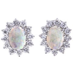 18 Carat Gold 0.88 Carat Opal Diamond Gold Oval Halo Stud Earrings
