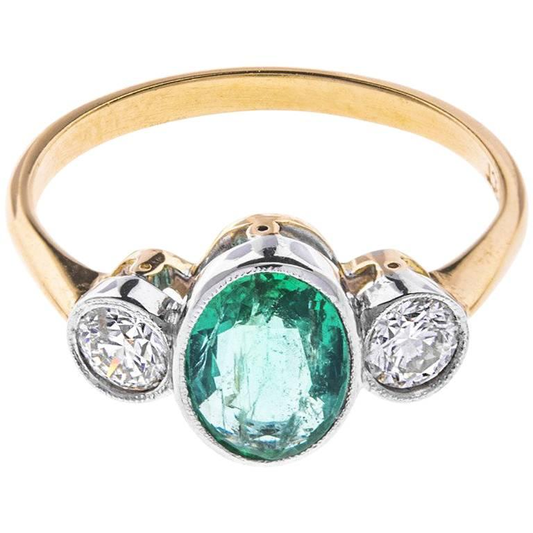 18 Carat Gold 1.10 Carat Emerald and 0.50 Carat Diamond Trilogy Ring