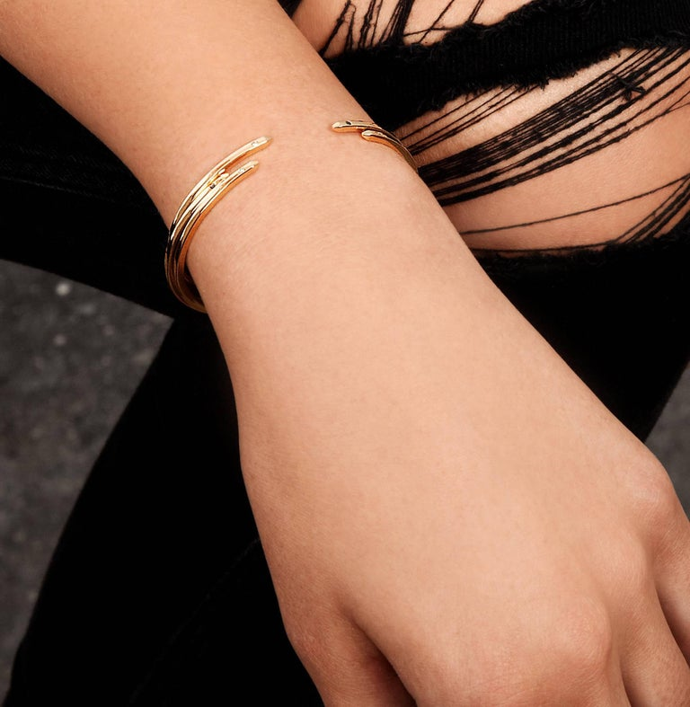 An elevated take on a jewellery basic, our 2mm-square cuff in 9-carat yellow gold has square beveled edges and two white diamonds.  Total diamond carat weight .016 carats.  The bracelet is slightly flexible to enable a customised fit for the