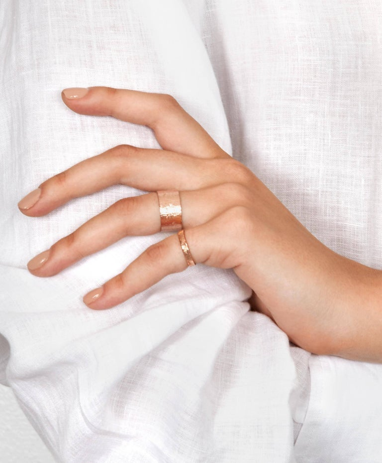 This textured band ring crafted in 18-carat rose gold has a unique shimmering texture on the exterior and a high polish finish on the inside and sides for a comfortable fit.  In stock in UK size G (US size 3 3/8), a standard pinky ring size.  Other