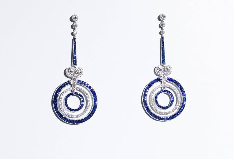 Earrings, 950/0 platinum, circa 2.5 carats sapphires with intense color – medium to dark blue – matched to graduate perfectly and circa 1.5 carats of diamonds. Elegant and feminine earrings – the sapphire and diamond rings are flexible and sparkling