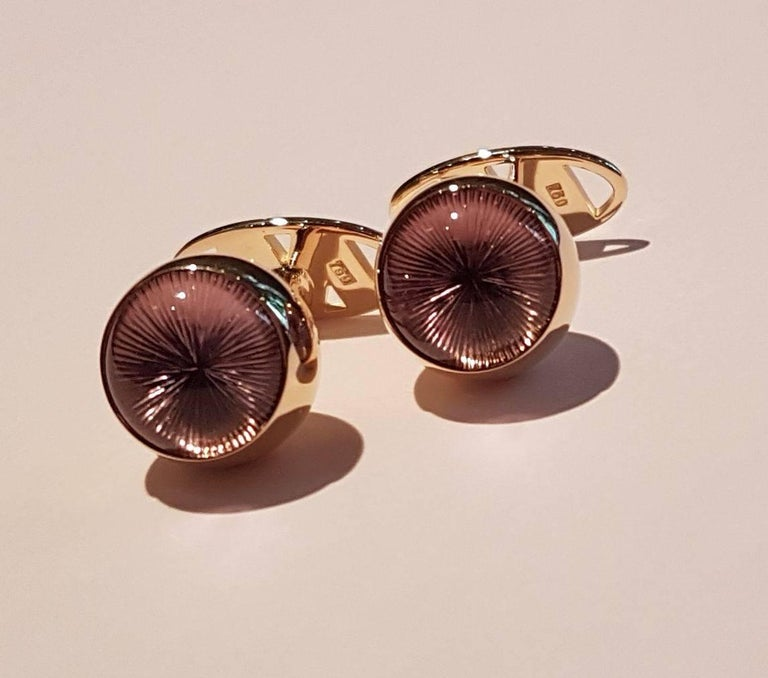 "Cufflinks, 18 carats red gold, amethyst cabochon with ""sun"" engraving. Very elegant for todays gentlemen."